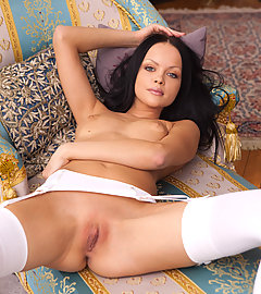 Young hottie in sexy white stockings opens her pussy wide
